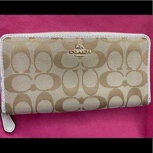 Cream colored coach Zippy wallet